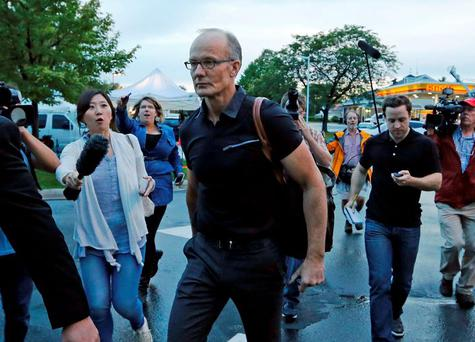 Frosty reception: Walter Palmer is surrounded by protesters and media at his dental clinic in Minnesota on Tuesday. Palmer shut his practice in July after he was identified as the hunter who killed Cecil the lion