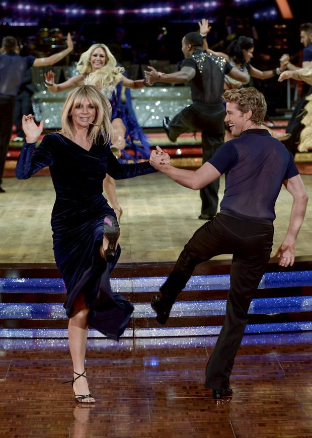 Zoe Ball dances with Kevin Clifton during a photocall to launch the Strictly Come Dancing Live Tour 2015 at Birmingham Barclaycard Arena on January 15, 2015 in Birmingham, England. (Photo by Richard Stonehouse/Getty Images)