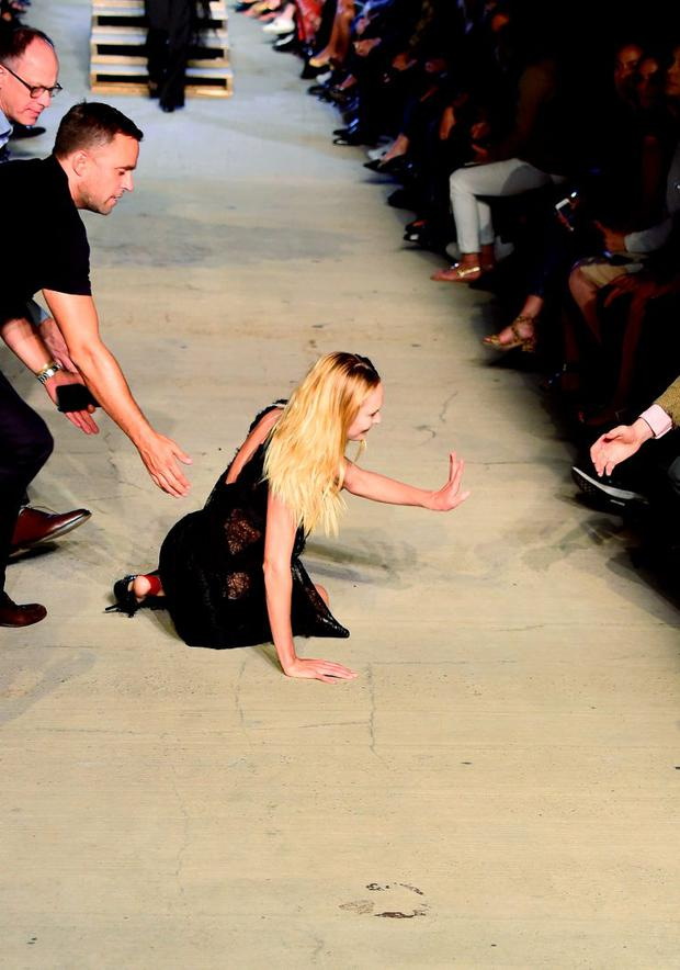South African model Candice Swanepoel stumbles and falls on runway during the Givenchy Spring 2016 fashion show during New York Fashion Week at Pier 26 at Hudson River Park on September 11, 2015 in New York City. (Photo by Frazer Harrison/Getty Images)