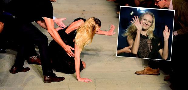 Model Candice Swanepoel falls on the runway wearing Givenchy Spring 2016 during New York Fashion Week at Pier 26 at Hudson River Park on September 11, 2015 in New York City. (Photo by Frazer Harrison/Getty Images)