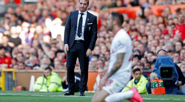 Liverpool manager Brendan Rodgers looks at Burnley's Danny Ings