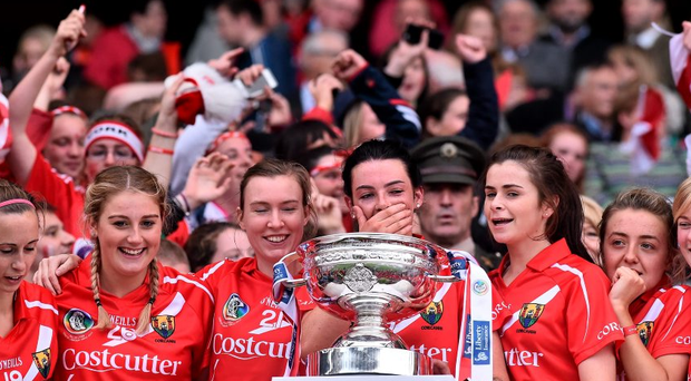 13 September 2015; Cork captain Ashling Thompson, centre, celebrates with her team-mate's after being presented with the O'Duffy cup. Liberty Insurance All Ireland Senior Camogie Championship Final, Cork v Galway. Croke Park, Dublin. Picture credit: David Maher / SPORTSFILE