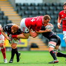 Andrew Conway, Munster, is tackled by Sam Underhill and Dan Baker, Ospreys