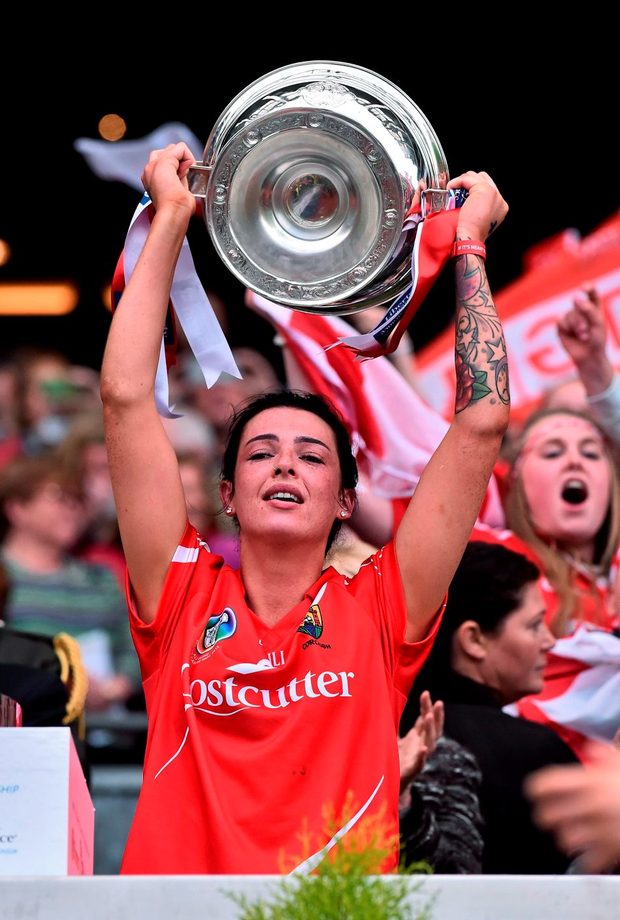 Cork captain Ashling Thompson lifts the O'Duffy cup