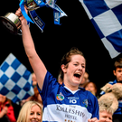 Niamh Dollard, Laois, lifts the cup after victory over Roscommon