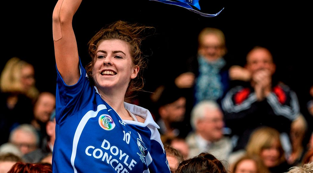 Waterford captain Caithriona McGlone is held aloft as she lifts the cup