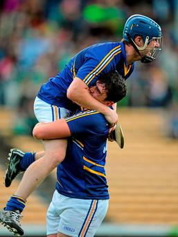 Wicklow players Marc Lennon, left, and Jim Doyle celebrate after the final whistle of their All-Ireland U21 B Championship final in Thurles