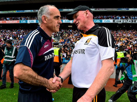 Anthony Cunningham, Galway manager, shakes hands with Brian Cody