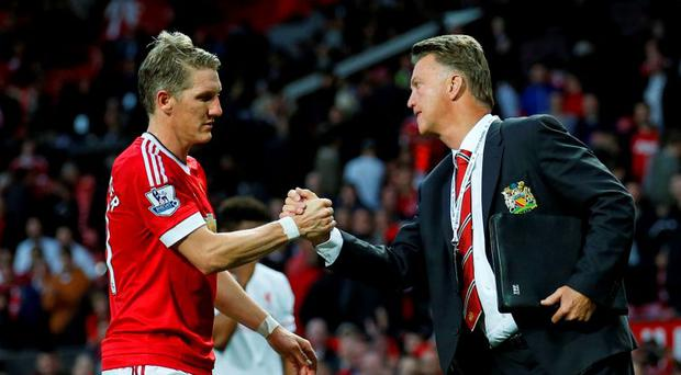 Manchester United manager Louis van Gaal celebrates with Bastian Schweinsteiger at the end of the match