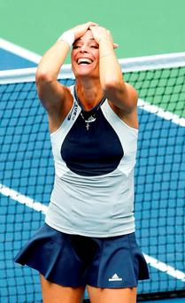 Flavia Pennatta reacts after winning the women's singles at the US Open