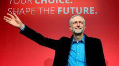 Jeremy Corbyn takes to the stage after he was announced as the Labour Party's new leader at a special conference in London