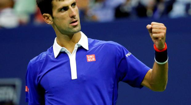 Novak Djokovic, of Serbia, reacts after winning a point against Roger Federer, of Switzerland, during the men's championship match of the U.S. Open tennis tournament