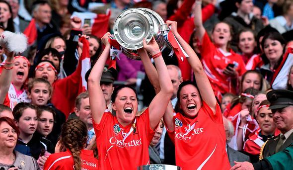 Cork players Gemma O'Connor, left, and Orla Cotter, lift the O'Duffy cup. Liberty Insurance All Ireland Senior Camogie Championship Final, Cork v Galway. Croke Park, Dublin. Picture credit: David Maher / SPORTSFILE