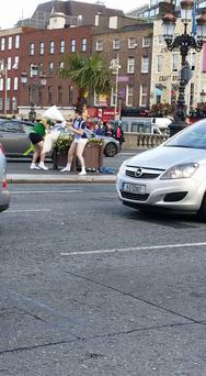 Two men wearing Kerry and Dublin jerseys and little else were caught pillow-fighting on O'Connell Bridge