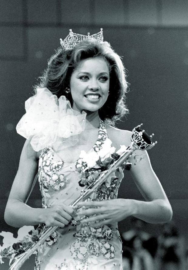 In this Sept. 17, 1983 file photo, Miss New York Vanessa Williams appears during her coronation walk after she was crowned Miss America 1984 at the Miss America Pageant in Atlantic City, N.J.