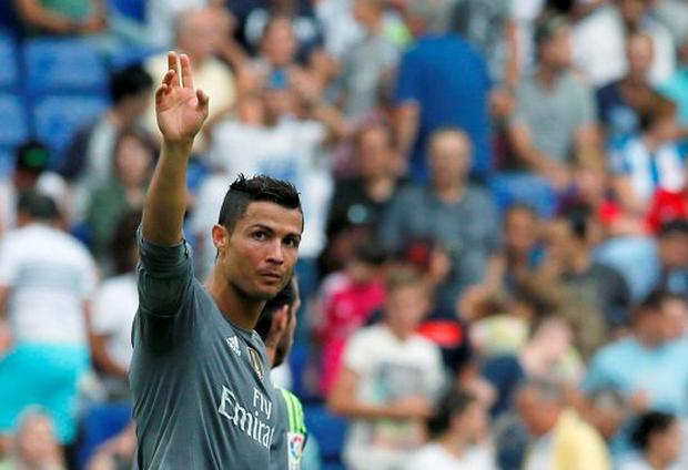 Real Madrid's Cristiano Ronaldo celebrates a goal against Espanyol during their Spanish first division soccer match in Cornella de Llobregat, near Barcelona, Spain, September 12, 2015