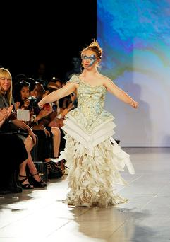 Model Madeline Stuart walks the runway at Hendrik Vermeulen show during Spring 2016 during New York Fashion Week