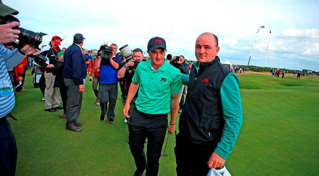 Great Britain and Ireland captain Nigel Edwards and Paul Dunne walk off 18th green after he secured the victory over the USAputts on the first green during day two of the Walker Cup at Royal Lytham & St Annes Golf Club, Lytham St Annes
