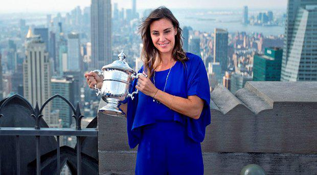 Flavia Pennetta, of Italy, holds the U.S. Open tennis women's singles championship trophy during a visit to the Top of the Rock Observation Deck at Rockefeller Center, Sunday, Sept. 13, 2015, in New York