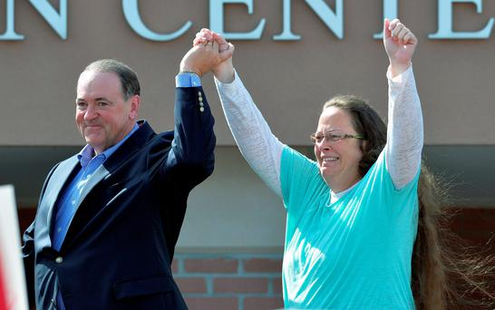 Rowan County Clerk Kim Davis, with Republican presidential candidate Mike Huckabee, greeting crowds after being released from the Carter County Detention Center Credit: Timothy D. Easley