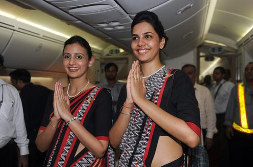 Air India flight attendants pose for a photo during the unveiling of Air India's first Boeing 787 Dreamliner in 2012. Photo: RAVEENDRAN/AFP/GettyImages