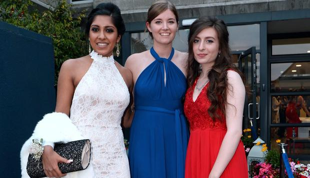 Saifa Kahani, 18, from Sydney Parade (wearing a dress her mom sourced for her), Lara Gallagher, 18, from Booterstown (wearing Pamela Scott dress), and Bebhinn Campbell, 18, from Greystones (wearing dress from axparis.com) arrive for their school Debs reception. St. Andrews College Dublin, Booterstown, Dublin.