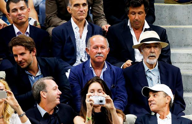 Sean Connery and Bradley Cooper watch the 2015 US Open Men's singles final match. Photo: AFP