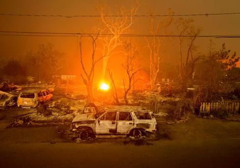 Burned out remains of vehicles and homes scorched by the Valley Fire line Wardlaw St. in Middletown, California REUTERS/Noah Berger