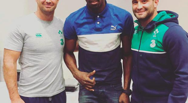 Usain Bolt with Rob and Dave Kearney during his visit to the Irish camp