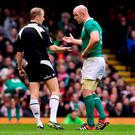Paul O'Connell talks to referee Wayne Barnes during Ireland's Six Nations defeat in Wales in March