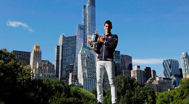 Novak Djokovic with the US Open trophy in New York's Central Park yesterday