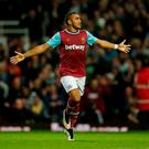 Dimitri Payet celebrates emphatically after scoring his second goal of the night