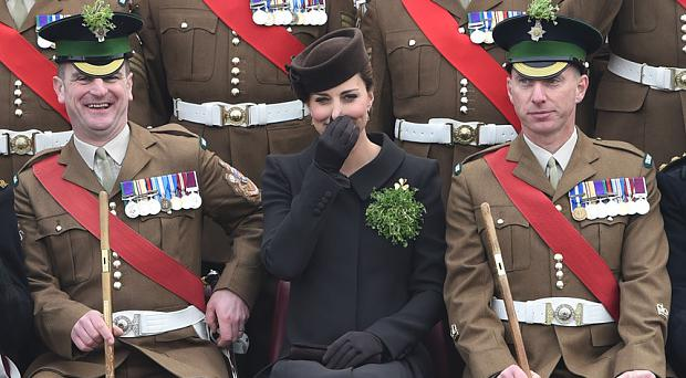 The Duchess of Cambridge poses with the Regimental Sergeant Major, WO1 Bryn Taylor, during a portrait photograph with The Irish Guards on St Patrick's Day this year
