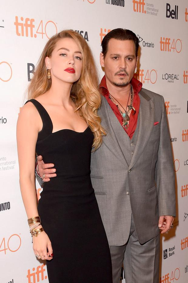 Actress Amber Heard and actor Johnny Depp attends the