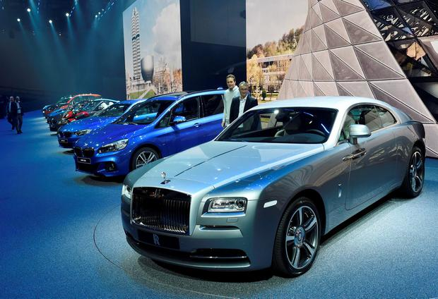 A Rolls Royce Wraith, front, and other cars of the BMW group are presented on the first press day of the Frankfurt Auto Show IAA in Frankfurt, Germany, Tuesday, Sept. 15, 2015. The car show runs through Sept. 27. (AP Photo/Jens Meyer)