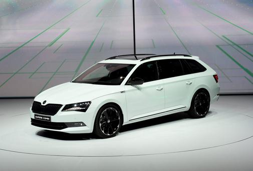 The new Skoda Superb Combi is presented during the Volkswagen group night on the eve of the Frankfurt Auto Show IAA in Frankfurt, Germany, Monday, Sept. 14, 2015. (AP Photo/Jens Meyer)