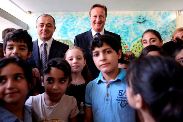 Lebanese Education minister Elias Bou Saab (L) with UK Prime Minister David Cameron during a visit to a school in Beirut Credit: Stefan Rousseau