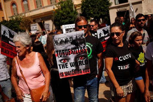 Animal rights activists take part in a protest against the