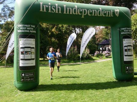Darragh Wilson and Edward Sheehy cross the finish line at the 2015 Sheep's Head Challenge in Ahakista, West Cork