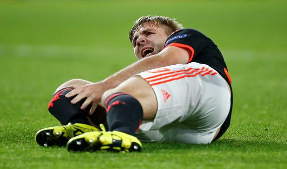 Manchester United's Luke Shaw reacts after sustaining an injury