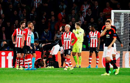 Luke Shaw lies on the ground injured during the UEFA Champions League Group B match between PSV Eindhoven and Manchester United