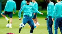Diego Costa, pictured here going through his paces at training yesterday, faces the axe for tonight's match