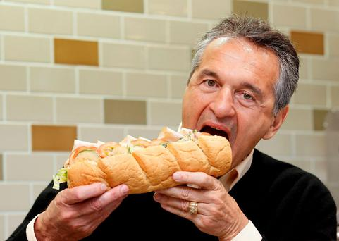 Subway co-founder Fred DeLuca poses in a Subway branch in central London REUTERS/Stefan Wermuth/Files