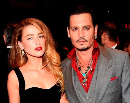 Amber Heard with husband Johnny Depp