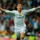 Real Madrid's Cristiano Ronaldo celebrates scoring a hat-trick against Shakhtar Donetsk at Bernabeu last night