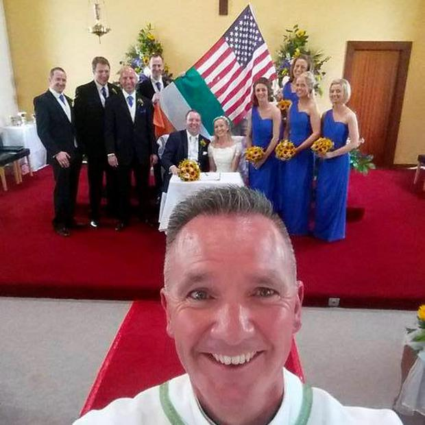 Fr John Kenny with a wedding party Pic: Fr John Kenny/Facebook