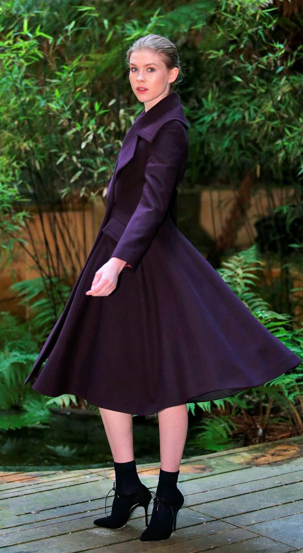Eve Connolly, wears a plum fit and flare double breasted coat at EUR495, ivory crepe top at EUR155 and satin skirt at EUR220 pictured at the Hugh Lane Gallery