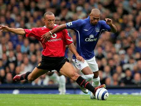 Marcus bent in action against Manchester United