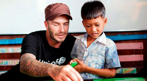 David Beckham visiting a Drop In Centre in Cambodia