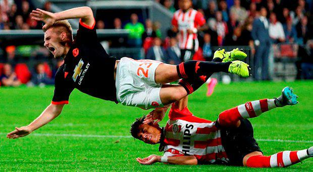 PSV's Hector Moreno, right, tackles Manchester Uniteds Luke Shaw, left, during the Champions League Group B soccer match between PSV and Manchester United at Philips stadium in Eindhoven, Netherlands, Tuesday, Sept. 15, 2015